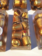 BLACK GOLD . 17 x 8 x 5 cm . nespresso capsules, resin . Ed of 100 - 73-100/100 available .  2015 - 2019 . price incl. MwSt: 890,- Euro